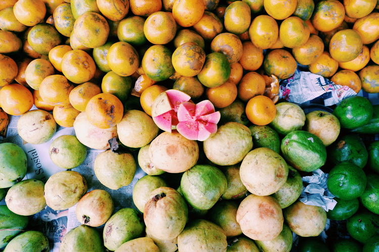 Guava and other Fruit Guava  Orange Pink Photography Jakarta Photo Foto Colors Market Full Frame Variation Directly Above Retail  Vegetable Close-up Food And Drink Farmer Market Street Market Shop Farmer's Market Price Tag