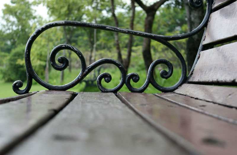 Close-up of metal railing on footpath