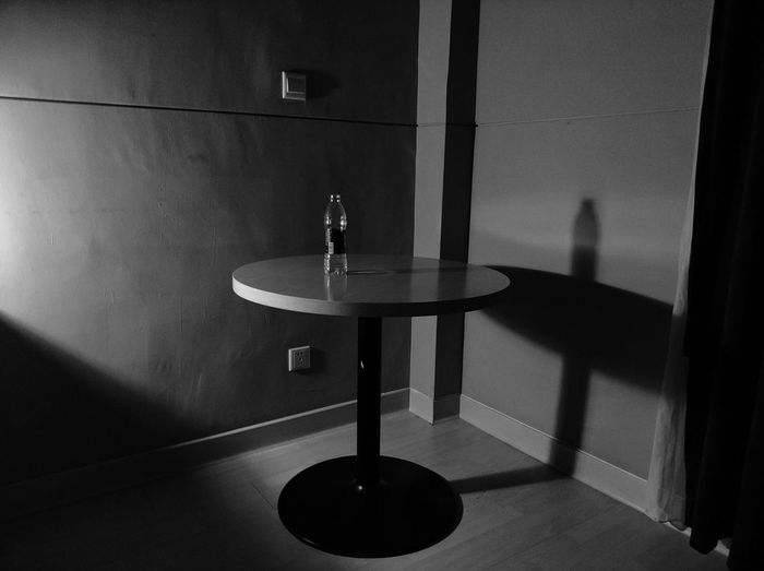 Water bottle on table against wall