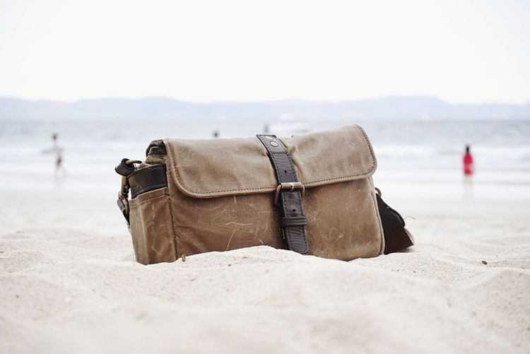 Nha Strang Vietnam ONA Bags Sea Beach Luggage Suitcase Sand Leaving Walking Men Rear View Business Finance And Industry