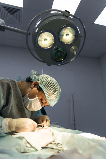 Side view of surgeon working in operating room