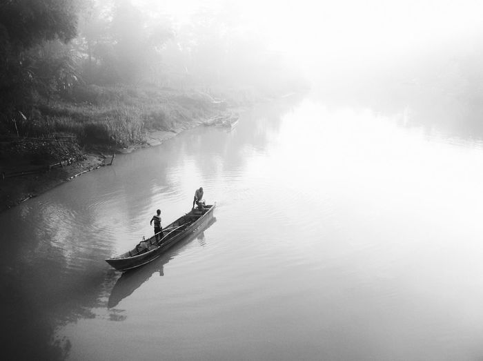 River activity in the morning fog