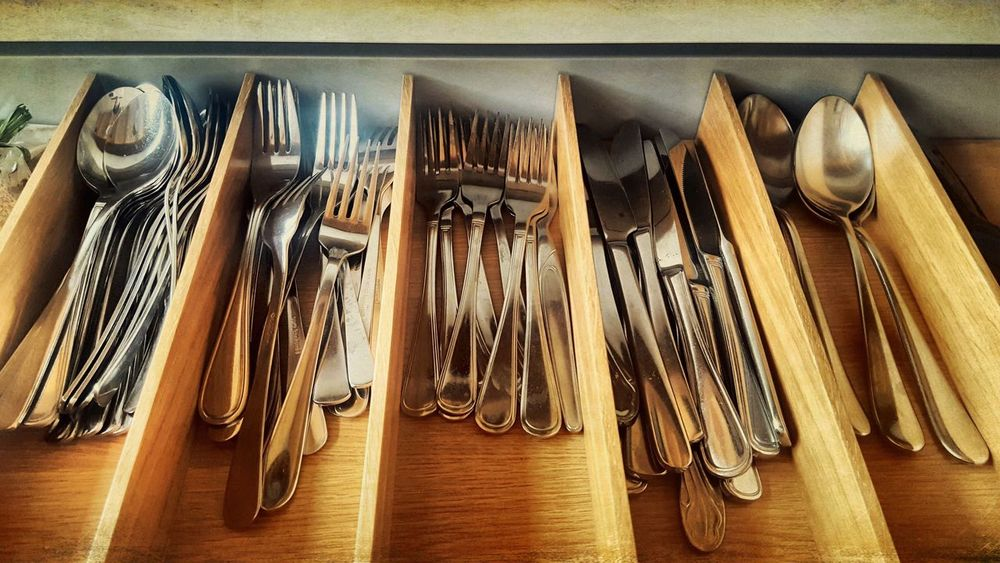 Variation Indoors  Wood - Material No People Fork Large Group Of Objects Neat Choice Stainless Steel  Wooden Spoon Close-up Day Cutlery Silver - Metal Silver Colored Silverware  Spoons Knife Kitchen Utensils Kitchen Drawer In A Row Still Life Kitchen Life Silver