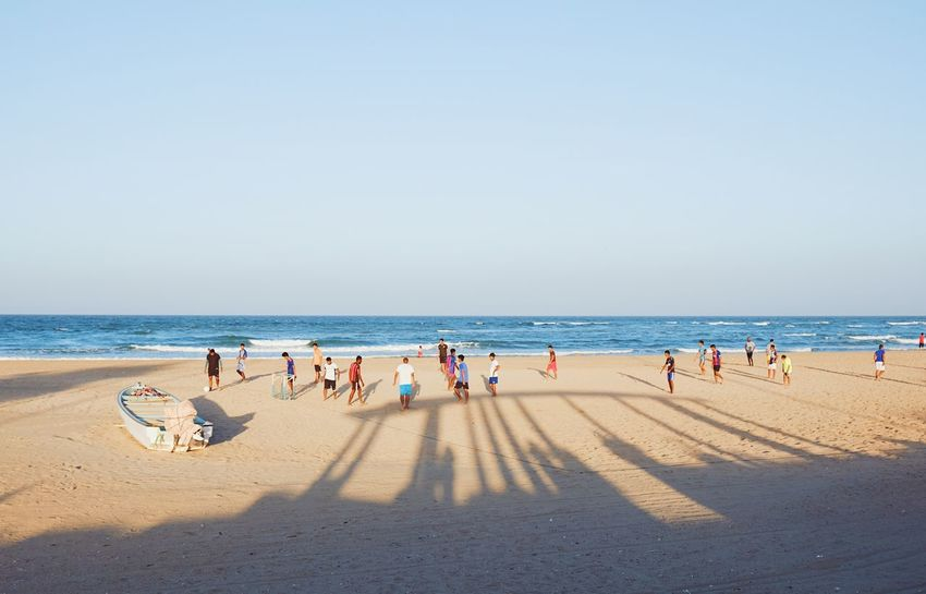 Beach Life Football Oman Adult Adults Only Beach Beauty In Nature Clear Sky Day Horizon Over Water Large Group Of People Men Nature Oman_photography Only Men Outdoors People Sand Sea Shadow Sky Summer Sunlight Water Şūr