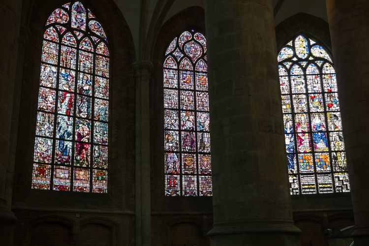 Stained Glass Place Of Worship Religion Indoors  Window Spirituality No People Arch Architecture Travel Destinations Abbey Low Angle View Multi Colored Medieval Holland Delft Historical Building The Netherlands Monument City Architecture Old Town Day