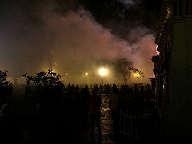 """Parque de Remedios envuelto en humo del fuego de """"voladores"""". Adult Fire Firework Display Nature Night Outdoors People Sky Smoke"""