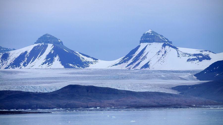 Spitsbergen Coast Spitsbergen Glacier Svalbard  Arctic Circle Mountain Cold Temperature Snow Scenics - Nature Beauty In Nature Water Snowcapped Mountain Tranquil Scene Tranquility Waterfront Mountain Range Sky Nature Lake Idyllic No People Environment Mountain Peak Ice