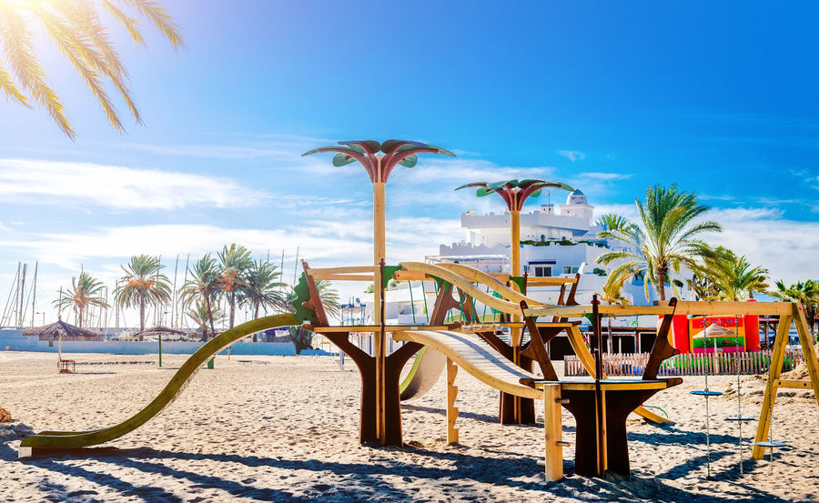 Children playground on the sunny tropical beach. Marbella, Spain Andalucía Beach Beauty In Nature Blue Sky Childhood Children Coast Costa Del Sol Europe Malaga Marbella Nature No People Outdoors Palm Trees Playground Sandy Beach Seaside SPAIN Summer Sun Sunny Day Tourist Resort Tropical Climate Vacations