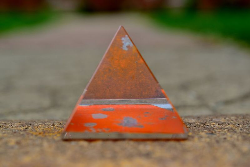 glass pyramid. Close-up Focus On Foreground Glass Pyramid Outdoors Triangle Shape