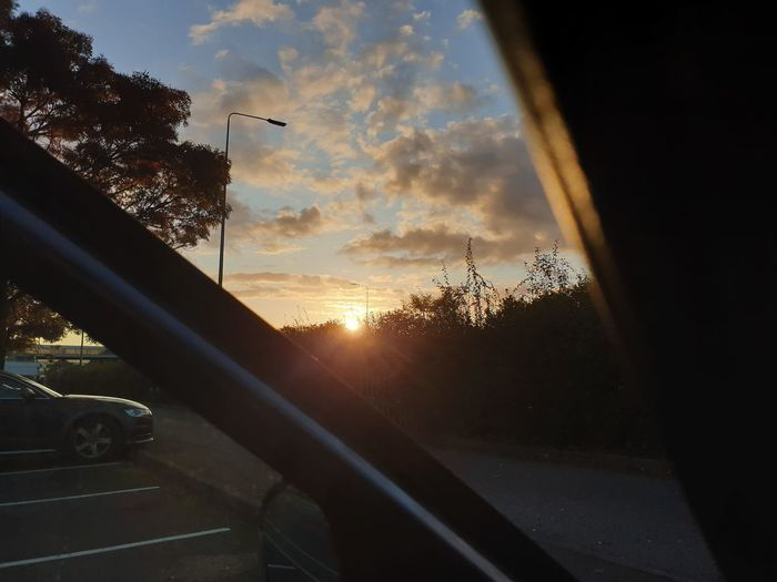 Sunset seen through car window