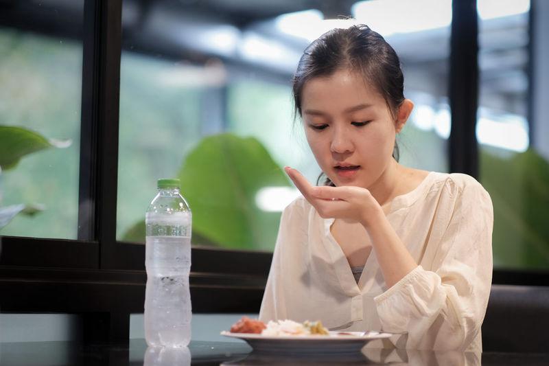 Woman looking at restaurant