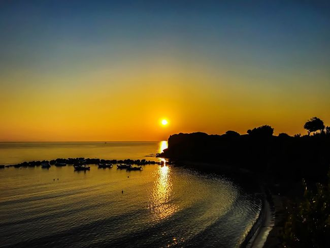 Sunset Sea Scenics Water Beauty In Nature Silhouette Nature Tranquil Scene Beach Tranquility Sky Sun Vacations Horizon Over Water Landscape Outdoors Horizon No People Clear Sky