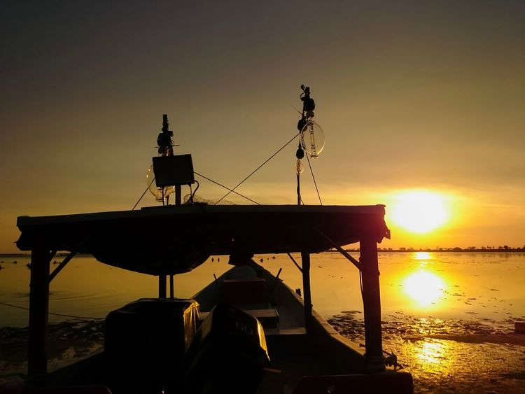 Sunset Reflection Dawn Of A New Day Dawnsky Silhouette Fisherman Boat Sunset Sky Water Silhouette Sea Orange Color Beauty In Nature Mode Of Transportation Nautical Vessel Nature Transportation Beach Non-urban Scene Built Structure Architecture Outdoors Sun Scenics - Nature