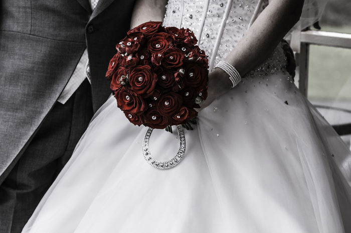 'Bride- grunge look' Bride Bride And Groom Celebration Close-up Day Grunge Life Events Lifestyles Love Lucky Horseshoes Midsection People Real People Red Flowers Red Roses Wedding Wedding Day Wedding Dress Wedding Flowers Well-dressed