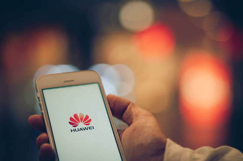 PHUKET, THAILAND - MAY 29, 2019: hand holding smartphone with screen of huawei logo, Google blocks Huawei's access to Android updates on may 20 and US delays Huawei ban for 90 days afterward Huawei Us Access Android Ban Block Bokeh China Company Delay Device Editorial  Focus Future Gadget Google Hand Hold Icon Illustrative ISSUE Light Logo Mobile Network Phone Prohibition Screen Selective Smartphone Supply Surface Technology Telecommunication Update