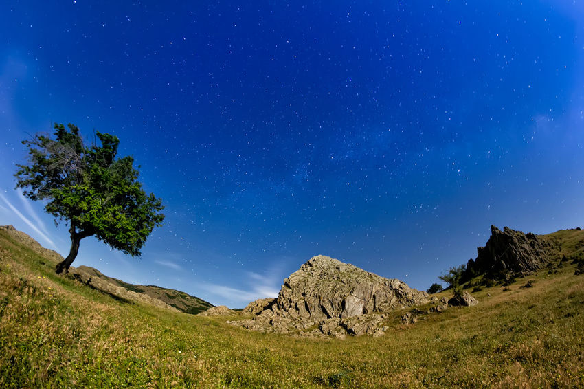 Beautiful Galaxy Hills Lonely Rock Formation Travel Astronomy Blue Sky Clouds Idyllic Landscape Milky Way Mountain Mountains Night Nightscape Non-urban Scene Outdoors Scenics - Nature Sky Starry Stars Summer Tree Universe