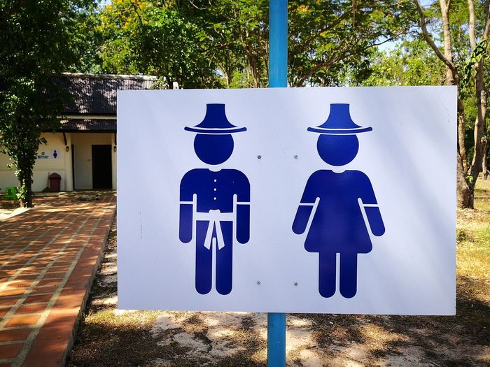 thailand toilet Thailand Travel Destinations Symbol Toilet Rentroom EyeEm Selects Thaistyle Menandwomen Ready To Go Tree Plastic Tape Blue Tape Walkway Sidewalk Road Sign Differing Abilities Human Representation Information Symbol Information Sign Information Restroom Sign Directional Sign One Way