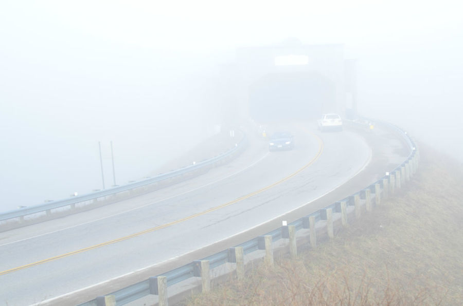 concrete covered bridge on small highway on foggy morning Archiecture Built Structure Car On Road Cars On Highway Covered Bridge Fog Foggy Day Foggy Morning Highway Road