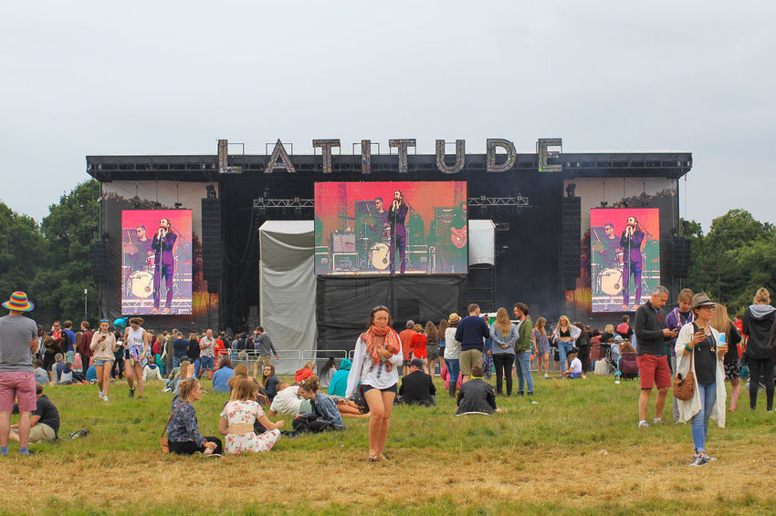 Scenes from the 2016 Latitude festival in Southwold, Suffolk. Casual Clothing Crowd Cultures Day Enjoyment Festival Grass Grass Large Group Of People Latitude Latitude Festival Latitudefestival Leisure Leisure Activity Lifestyles Nap Outdoors Relax Relaxation Sky Tourism Tourist