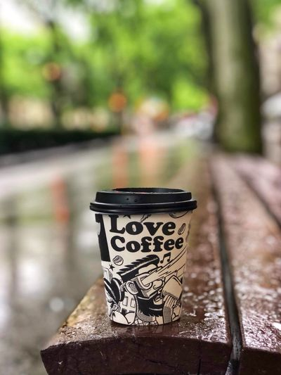 There is nothing better on a cool rainy day than a cup of hot, aromatic coffee. Disposable paper cup of coffee on the wet bench of the city alley. Barcelona Bench City Street City Life Rain Rainy Days Disposable Cup Coffee Cup Coffee - Drink Coffee Focus On Foreground No People Close-up Day Art And Craft Pattern Outdoors Cup Food And Drink Container Selective Focus Still Life Wood - Material Single Object Mug Creativity