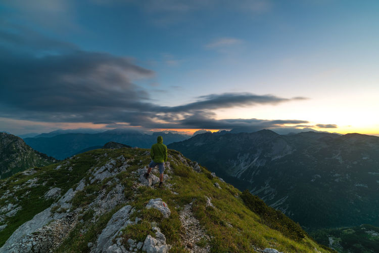 Sunrise on top of Šmohor Beauty In Nature Cloud Dawn Exposure Idyllic Landscape Long Majestic Morning Mountain Mountain Range Nature Outdoors Peak Person Photography Remote Scenics Slovenia Summer Sunlight Sunrise Tranquility