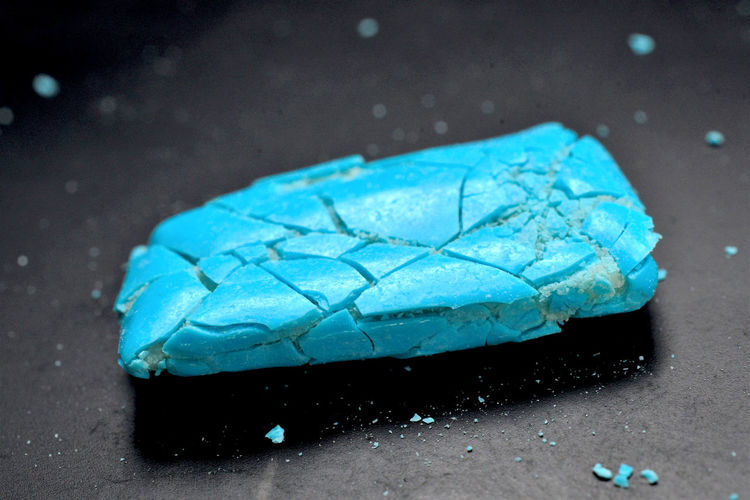 High angle view of wet blue car