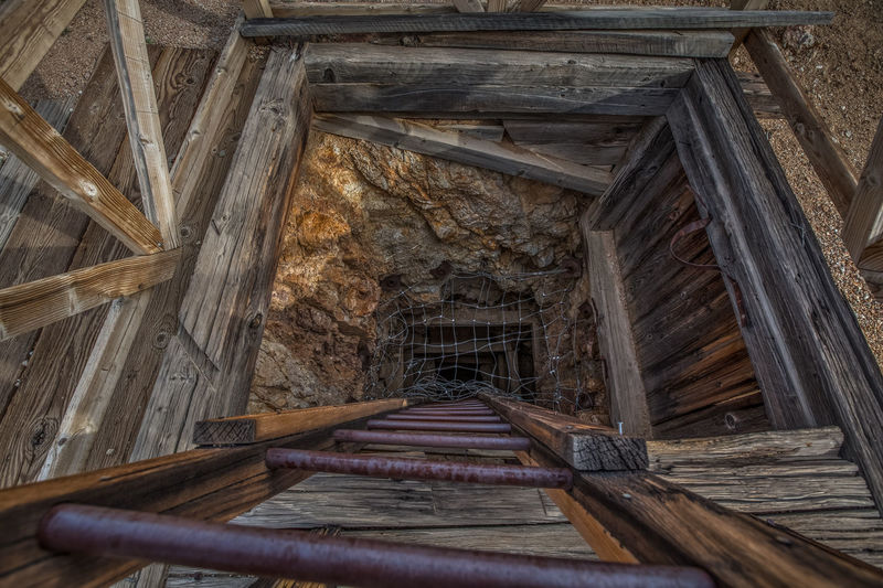Vertical mine shaft near Skidoo town site in Death Valley National Park, California. California Death Valley Death Valley National Park Descending Desert Ladder Remote Location United States Abandoned Built Structure Down Historic Mine Mining No People Shaft Skidoo Travel Destinations Vertical