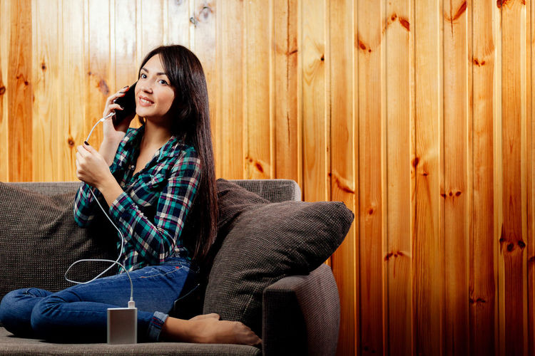 charging phone with powerbank. woman using powerbank when battery low. Females Power Power Bank PowerbankCable Woman Accumulator Battery Charger Charging Chatting Close-up Communication Long Hair Low Battery Phone Powerbank Sexygirl Smartphone Speaking Speaking On The Phone