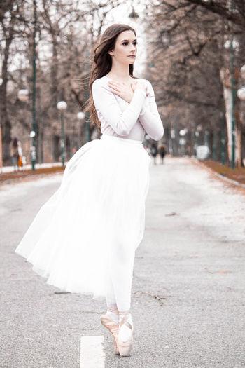 Ballerina dancing on road