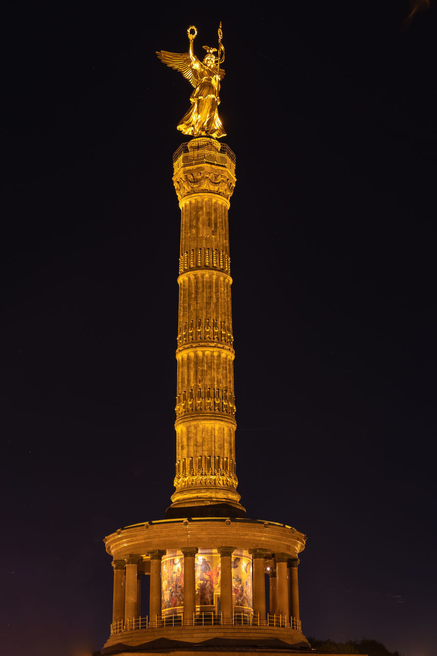 LOW ANGLE VIEW OF ILLUMINATED STATUE