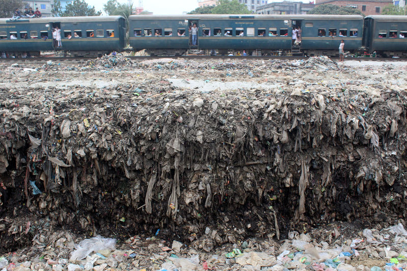 Heap of garbage by railroad tracks