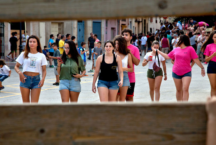 Teenage girls at the local summer festivities, Cherta, Tarragona Spain. Cherta Fashion SPAIN Tanned Teenagers  Day Denim Shorts Lifestyles Outdoors People Real People Sexygirl Summer Town Young Women