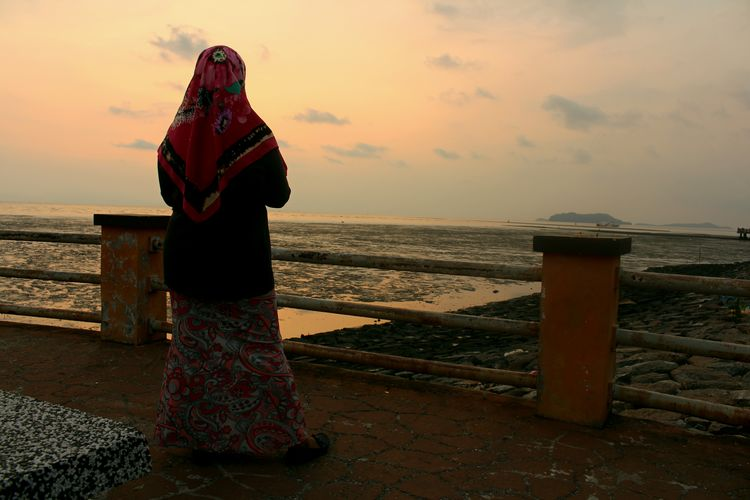Women and Sunset at Jeti Kuala Perlis Nature Adult Beach Beauty In Nature Horizon Over Water Land Leisure Activity Lifestyles Looking At View Nature One Person Outdoors Real People Scenics - Nature Sea Shore Sky Standing Sunset Water Women A New Beginning Humanity Meets Technology