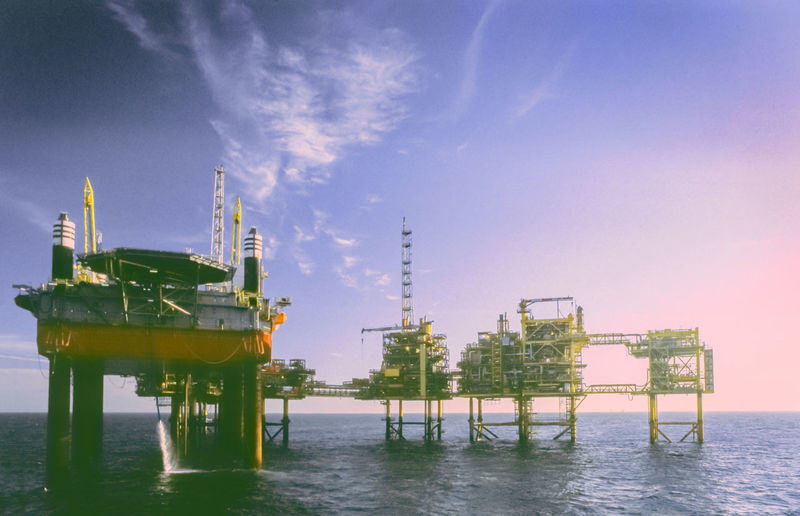 A maintenance rig alongside an oil platform complex.