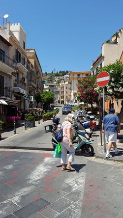Beautiful Streets Of Taormina Italy Editorial Only Taormina Italy Taormina Italy🇮🇹 Shopping People Watching Europe Vacation Travel Destinations Beautiful Colors In The Trees Old Buildings Building Exterior Street Day Outdoors Clear Sky Architecture Road