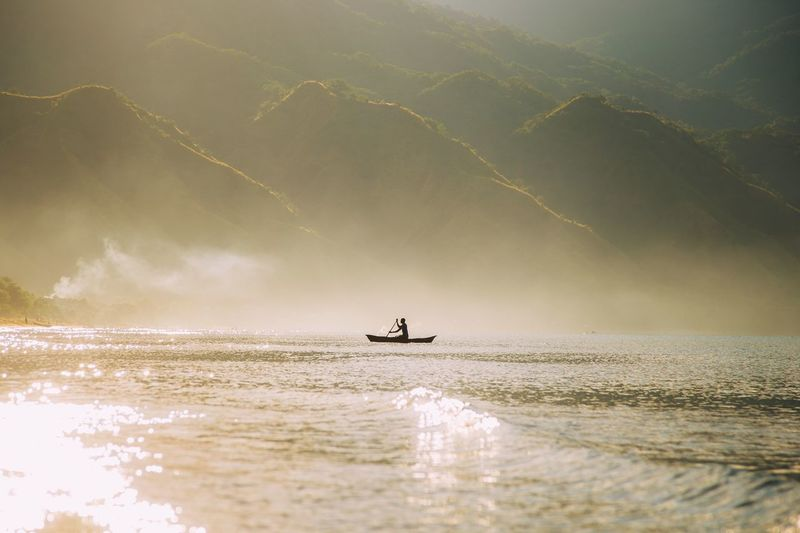 Misty, magical mornings. After spending the entire night just gazing at a sky full of stars and talking about everything and nothing with the lads, we're greeted with this scene as the sun rises behind the mountains. I can't fully express in words the feelings it stirred, but it was like nothing I had felt or seen before. Fishermanvillage Fisherman Boat Fisherman Travel Travel Photography Misty Morning Mist Water Sea Sky Land Beach Beauty In Nature Nature Scenics - Nature People Motion Sunset Cloud - Sky Outdoors The Great Outdoors - 2018 EyeEm Awards The Traveler - 2018 EyeEm Awards The Great Outdoors - 2018 EyeEm Awards The Traveler - 2018 EyeEm Awards