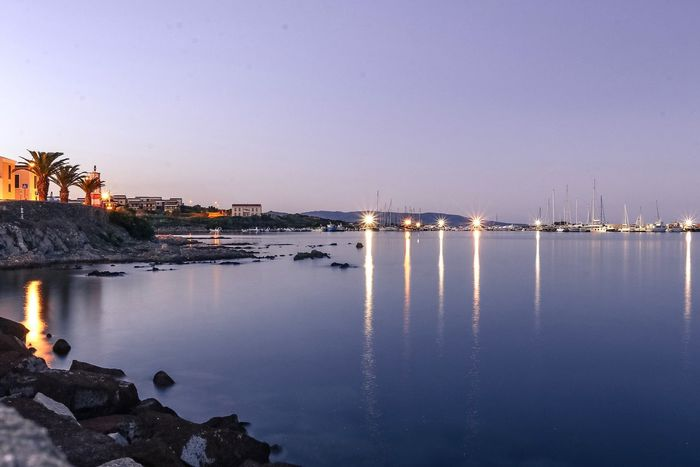 Quiet Stintino harbour. Water Reflection Built Structure Sunset Nature No People Architecture Clear Sky Sea Scenics Outdoors Building Exterior Sky Waterfront Beauty In Nature Tranquility Autumn Autumn Colors City Day Long Exposure Stintino Sardegna Sardinia Harbor Lost In The Landscape