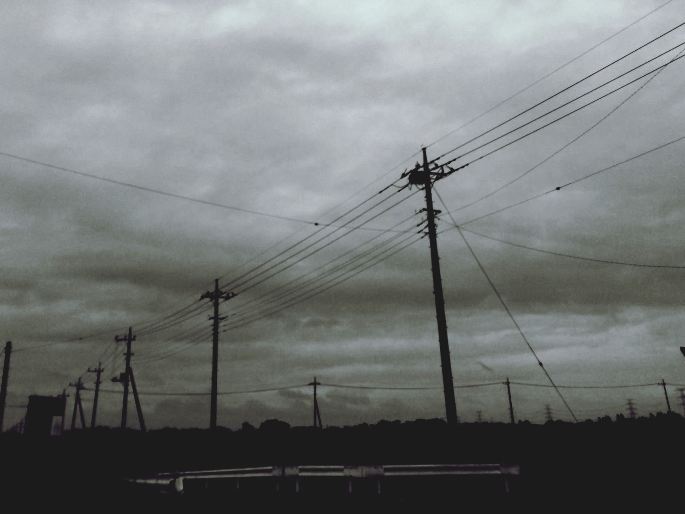 power line, electricity pylon, sky, power supply, silhouette, electricity, cloud - sky, connection, cable, fuel and power generation, cloudy, low angle view, sunset, technology, cloud, transportation, weather, overcast, dusk, power cable