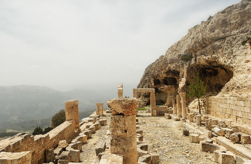 Alahan Monastery Alahan Monastery Alahan The Monastery Ancient Ancient Civilization Archaeology Architectural Column Architecture Beauty In Nature Built Structure Faith History Monastery Mountain Mut Nature Old Ruin Outdoors Religious  Religious Architecture Rock - Object Sky Stone Stone Material Travel Destinations Turkey