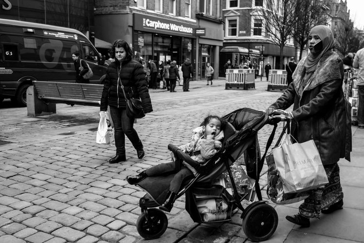 Handsfree? Child City Day Handsfree Mobile Mobile Conversations Mother People Phone Street Streetphotography Technology The Street Photographer
