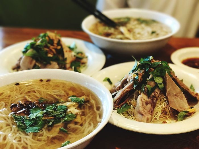 Close-Up Of Noodle Soups In Bowls Served On Table