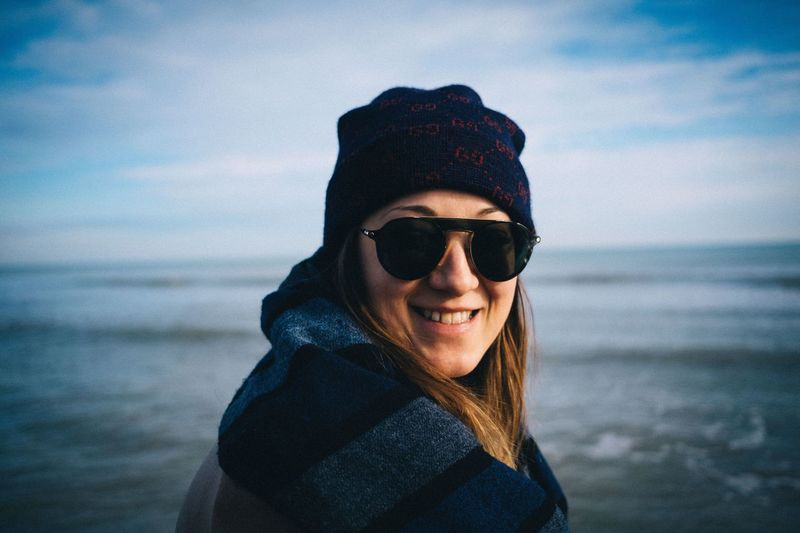 EyeEm Selects One Person Sunglasses Water Young Adult Fashion Portrait Glasses Clothing Sea Lifestyles Real People Sky Leisure Activity Smiling Young Men Nature Headshot Warm Clothing Horizon Over Water Outdoors International Women's Day 2019 International Women's Day 2019