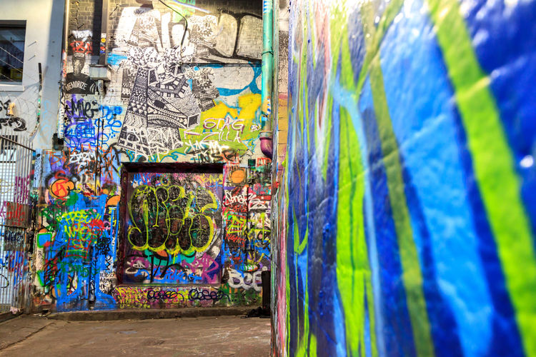 Graffiti close up Architecture Art And Craft Building Exterior Built Structure City Creativity Day Floral Pattern Graffiti Messy Multi Colored Mural No People Outdoors Paint Pattern Spray Paint Spraying Street Art Text Wall Wall - Building Feature
