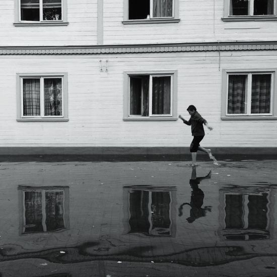 Maybe he won't get wet if he can run fast enough :) Blackandwhite Iphononly Streetphoto_bw IPhoneography
