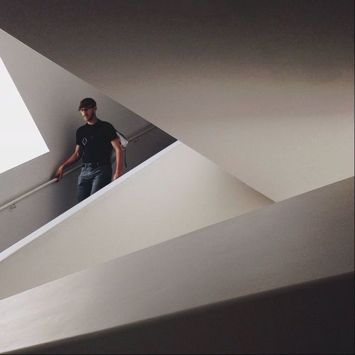 Man walking down on stairs in modern building