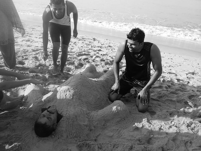 FriEnDs CaN'T Be MorE NauGhTy..ThaN ThiS...😂😂😂 Friends Sand Art Sand Art On The Beach Enjoying Friendship Black And White Light And Dark Day Outdoors People And Art In My Point Of View Scenic Sea Beachtime Togetherness Kerala This Is Masculinity