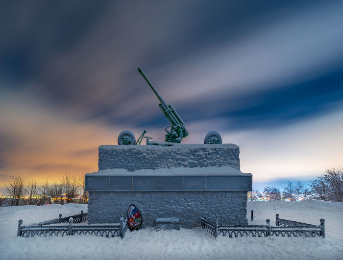 Memorial to the Soldiers of the 1st Air Defence Corps in Abram-Mys near Murmansk, Russia Memorial Murmansk Off The Beaten Track Russia WWII Air Defence Gun Air Defense Cloud - Sky Cold Temperature Long Exposure Monument No People Off The Beaten Path Sky Snow Tourist Destination Ussr Winter