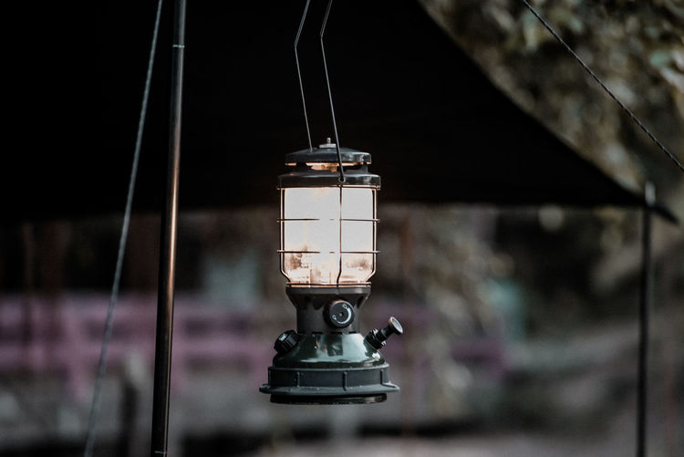 Close-up of electric lamp hanging