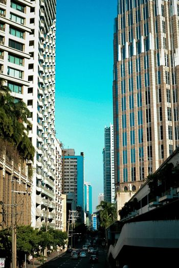 Concrete Jungle. Skyscraper Architecture Building Exterior City Built Structure Modern Urban Skyline Outdoors Cityscape Day No People Sky Philippines Tryphilippines Business Finance And Industry Office Building Exterior Landscape Makati City, Philippines. Philippine City Makati City, Philippines