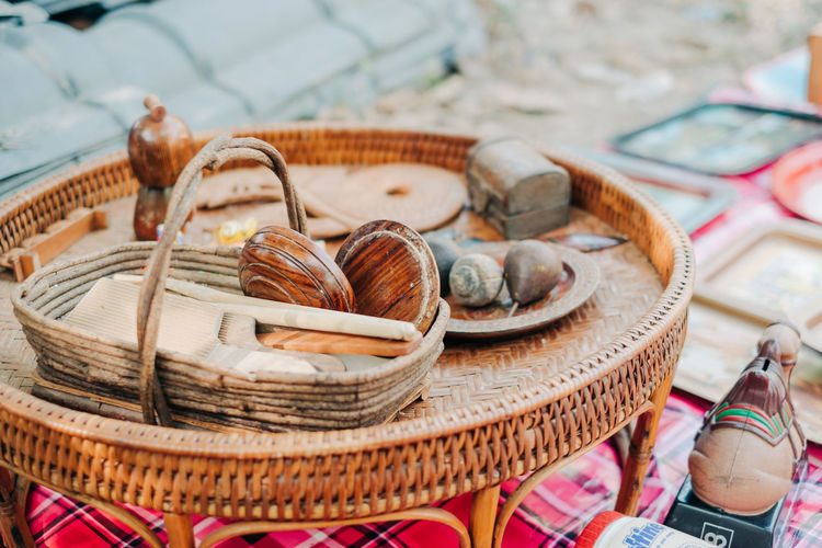 Close-up of wooden equipment on table at market stall